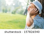 young man in a summer park on... | Shutterstock . vector #157826540