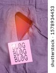 Small photo of Handwriting text Blog Blog Blog. Concept meaning Internet blogging trend modern virtual communication Smartphone device inside formal work trousers front pocket near note paper.