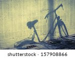Shadow Of A Bicycle On The Wall