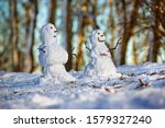 Two Little Snowmen On Snow In...