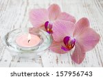 orchids and candle on a wooden... | Shutterstock . vector #157956743