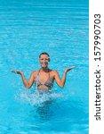young beautiful woman splashing ... | Shutterstock . vector #157990703