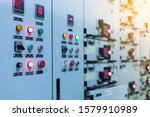 Small photo of Electrical selector switch,button switch,Electrical switch gear at Low Voltage motor control center cabinet in coal power plant. blurred for background.