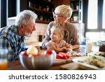 Happy Grandparents With...