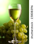 a glass of white wine and grape - stock photo