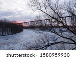 View of the 1908 railway trestle bridge over the Cap-Rouge River seen during a cloudy winter sunrise, Cap-Rouge area, Quebec City, Quebec, Canada