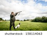 hunter with dog aiming with his ... | Shutterstock . vector #158114063
