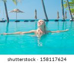 gorgeous female in a pool  | Shutterstock . vector #158117624