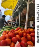 Small photo of TRINIDAD & TOBAGO- September 22, 2018: Patron shops for produce and fruits from the local market stall on the infamous, Charlotte Street, in the nation's capital, Port-of-Spain.