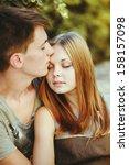 happy teen couple embracing at... | Shutterstock . vector #158157098