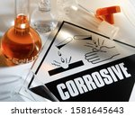 Small photo of Corrosive Warning Sign - A corrosive substance is one that will damage or destroy other substances with which it comes into contact by means of a chemical reaction.