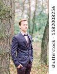 handsome elegant groom in... | Shutterstock . vector #1582008256