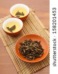 teapot and dried tea leave | Shutterstock . vector #158201453