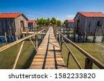 Wooden Houses In Patok Lagoon - Patok Fushe Kuqe Ishem Nature Reserve, Albania