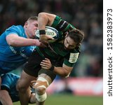 Small photo of Northampton, UK. 7th December 2019. Cobus Reinach of Northampton Saints is tackled by Tadhg Furlong of Leinster