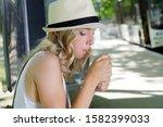 Blond Woman Smoking A Cigarett...