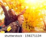 Happy Couple In Autumn Park....