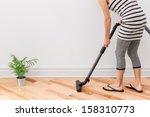 Housework. Young Woman Vacuum...