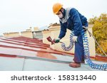 Roofer builder worker with...