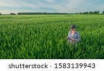 A Woman Farmer With A Tablet I...
