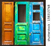Three Colored Old Wooden Doors...