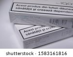 Small photo of 09 december 2019, Timisoara, Romania. - Two packs of Heets sticks. Close up shot. Romanian language on it which says - this type of product can harm your health.