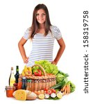 Young woman with assorted grocery products isolated on white background - stock photo