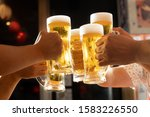 Image Of Toasting With Beer At...