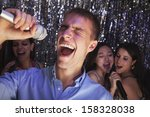 young man singing into... | Shutterstock . vector #158328038
