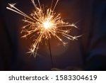 hand of woman holding firework... | Shutterstock . vector #1583304619