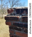 Deteriorating Chimney With Yar...