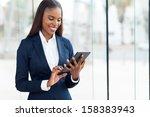 Cheerful African Businesswoman...