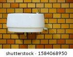 Old White Ceramic Sink On Bric...