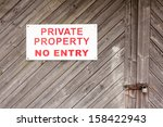 A Wooden Gate With A No Entry...