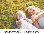 smiling mother and baby laying... | Shutterstock . vector #158445599
