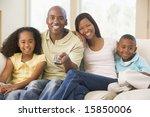 family sitting in living room...   Shutterstock . vector #15850006