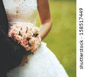bride and groom holding hands.... | Shutterstock . vector #158517449