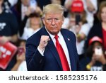 Small photo of HERSHEY, PA - DECEMBER 10, 2019:President Donald Trump gestures the confident fist pump on stage at a campaign rally at the Giant Center.