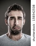 portrait of young man crying | Shutterstock . vector #158542538