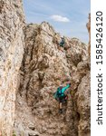Small photo of Dolomites - climbing via via Ferrata. Active recreation in Tyrol. Italian Alps.