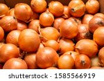 Small photo of a lot of yellow onions. yellow onions close up. Onions big Golden on the counter market. Fresh onions. Golden onion background . vintage photo processing