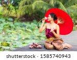 A Female Tourist Wearing A Thai ...