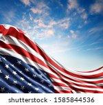 american flag in blue sky | Shutterstock . vector #1585844536