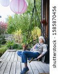 Mature Woman Relaxing In Chair...