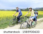 Young Family On Bicycles In...