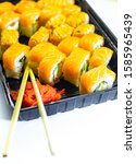 Small photo of Fresh salmon philadelphia rolls. Smoked salmon rolls. Set of rolls on the board, table. One piece of roll. Food delivery, sushi. A lot of roll. Sticks for rolls. Macro