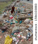 Small photo of Garbage dump on road side producing more pollution