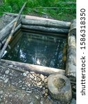 Small photo of natural source of clean water in the forest, ennobled by human hands.