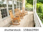 Rocking Chairs Invite One To...
