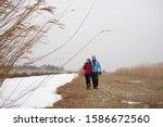 Senior Couple Walking Together...